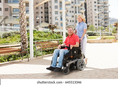 Real disabled man on the wheelchair. We are friends.