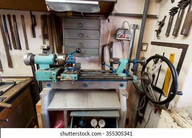 real domestic DIY home workshop full of tools, untidy, ready for work, detail of homemade lathe