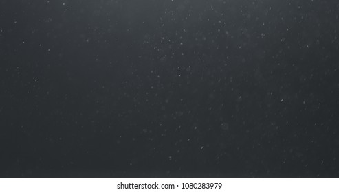 real dust floating in air over dark background