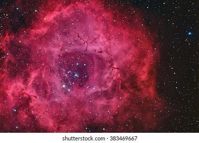 Real emission nebula named Rosette nebula taken with CCD through telescope