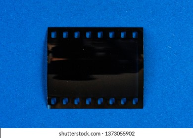 real empty, blank and exposed 35mm film strip on colourful background, film texture