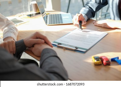 real estate agent dealer salesman using stamper for stamping approved on mortgage loan auto insurance contract agreement document