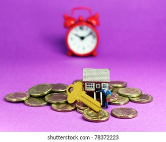 A real estate agent, in front of a small house with key,  gold coins scattered around and a red alarm clock in the pastel purple back ground, asking the question is it time to buy that dream house?