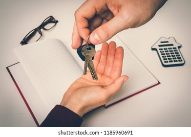 Real estate agent giving keys from new house to young woman - real estate sale concept - retro style