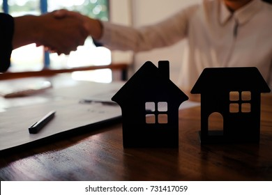Real estate agent handshake. Business partnership meeting concept. and home insurance