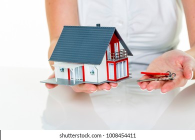 real estate agent with house and key