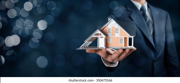 Real estate agent offer house represented by model. Wide banner composition with bokeh background.