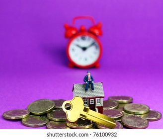 A real estate agent, on top of a small house with gold coins scattered around, with a golden key and red alarm clock in the pastel purple bank ground, asking the question wake up to your debt!