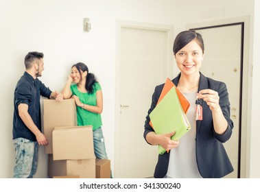 Real estate agent portrait with family getting new home. business concept about real estate market