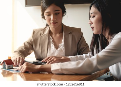 Real Estate Agent presenting and consult to customer to decision making sign insurance form agreement, concerning mortgage loan offer for and house insurance.