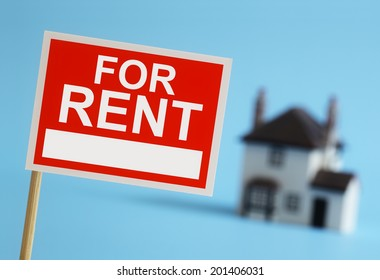 Real estate agent for rent sign with house in background