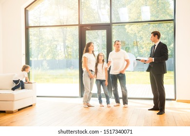 real estate agent is selling an apartment to a young family. conclusion of a lease and purchase of a house, apartment. man shows housing