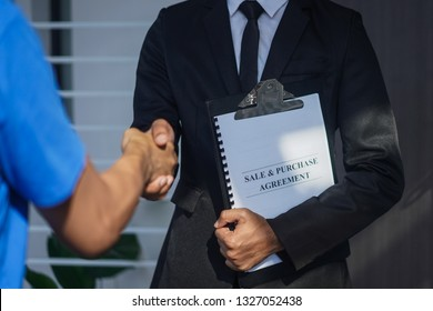 Real estate agent shake hand with client as buying house concept