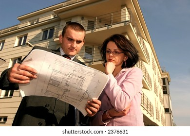 real estate agent showing flat location to potential buyer