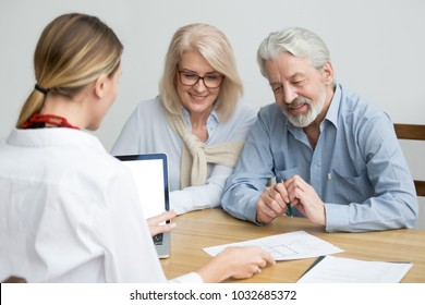 Real estate agent showing house plan to aged couple, realtor making property for sale offer to senior customers at meeting, financial advisor consulting older family negotiating about buying new home