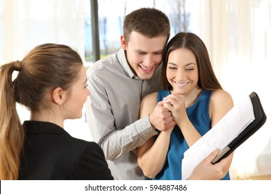 Real estate agent showing a new house plan to a nervous couple