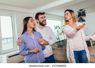 Real Estate agent shows interior to young couple