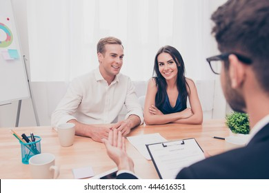 Real estate agent working with couple of customers in the office