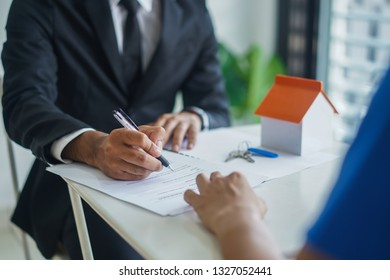 Real estate agent writing as signing agreement concept,