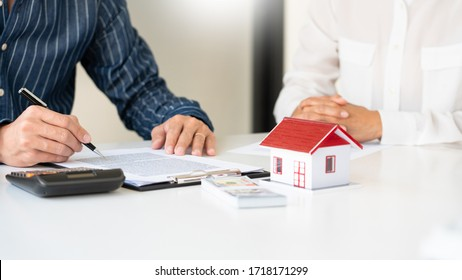 Real estate agents explain the document for customers who come to contact to buy a house, buy or sell real estate concept