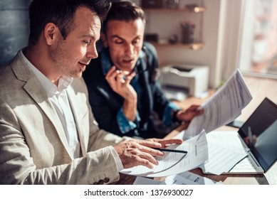 Real estate agents reviewing rental contract in the office