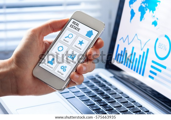 Real estate app concept on a mobile phone screen, person searching a house, apartment or property to buy or rent online on internet
