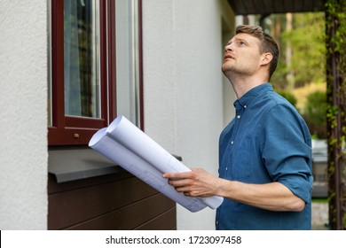 real estate appraisal - man doing property inspection outdoors