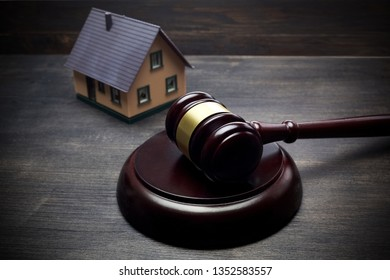 Real Estate Auction. Gavel and house on dark wooden background