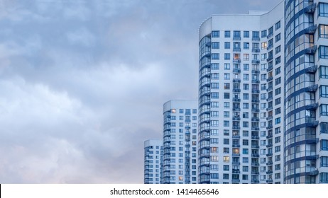 Real estate background. Ukrainian real estate market. Urban abstract background. Apartment building. Image of side view of big building with appartements at dusk. New apartments. Copy space
