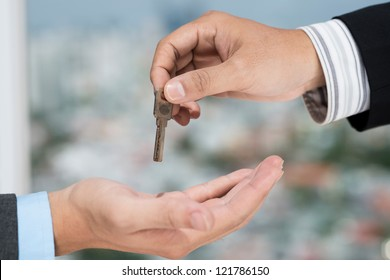 Real estate broker giving the key to the client