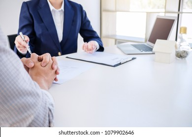 Real estate broker residential agent being analysis and making the decision a home estate loan to customer and waiting for his reply to finish house and car rent listing contract.