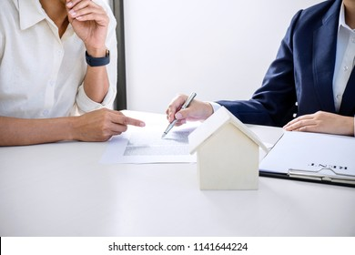 Real estate broker residential agent being analysis and making the decision a home estate loan to customer and waiting for reply to finish house and car rent listing contract.