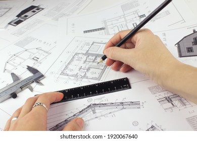 Real estate, building, construction, architecture concept. Architect engineer or design worker draw sketch plan blueprint of construction house building
