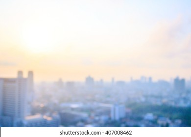 Real estate concept: Abstract blurred aerial view city on twilight color sky and clouds cityscape background