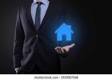 Real estate concept, businessman holding a house icon.House on Hand.Property insurance and security concept. Protecting gesture of man and symbol of house