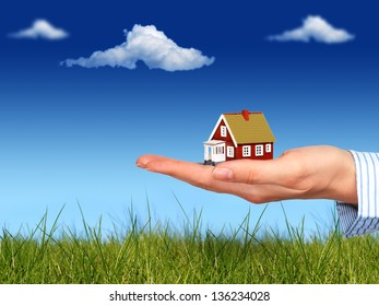 Real estate concept. House in hand.