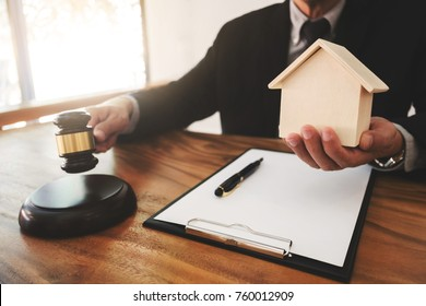 Real Estate concept, judge gavel / lawyer in auction with house model