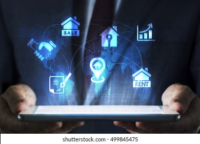 Real estate concept on tablet with hologram
