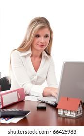 Real estate executive working on laptop