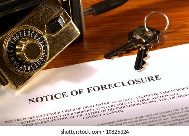 Real estate financial lender home foreclosure notice with set of house keys and open Realtor lock box (fictitious document with authentic legal language)