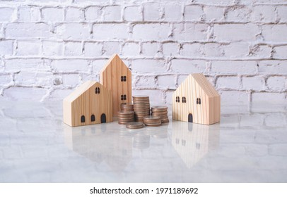 Real estate or home savings and coin piles flowing, property investment and home mortgage financing with bank loans, money and housing savings plans, financial concept and copy space