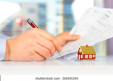 Real estate investment. Signing the loan papers.