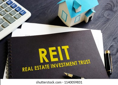 Real estate investment trust REIT on an office desk.