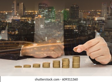 real estate investment,property investment, plan for housing concept. hand putting coin on coins stack.