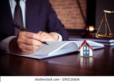 Real Estate Law concept. Gavel on table in a courtroom, working for the insurance compensations. report the case on table in modern office.