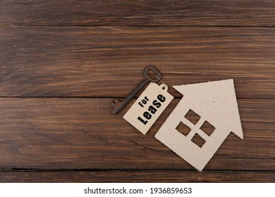 real estate lease concept old key with tag and cardboard house