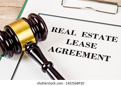Real Estate Lease Contract and gavel with document. Real estate law concept.