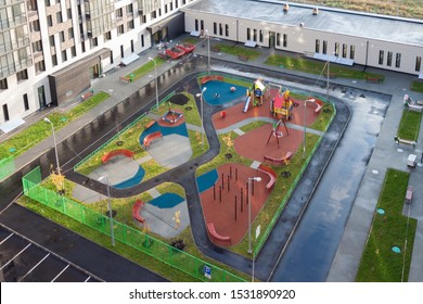 Real estate low-rise construction building exterior and playground for children in new residential area for sale. Urban development concept image