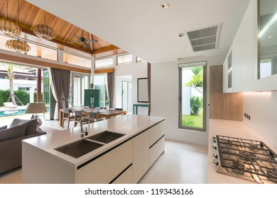 real estate Luxury interior design pool villa in kitchen area with feature island counter and built in furniture