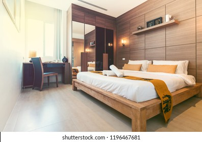 real estate Luxury Interior design in bedroom of pool villa with cozy king bed.high raised ceiling , home, house, vintage style